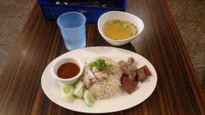 Eating Khao Man Gai at a Khao Man Gai restaurant near On Nut station.