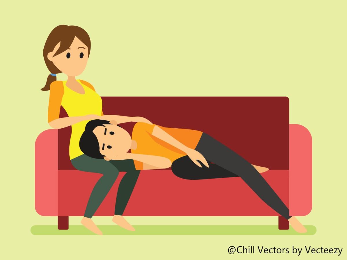 ソファに横になる人