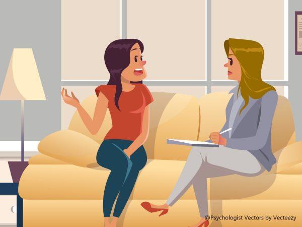 ソファで談笑する女性